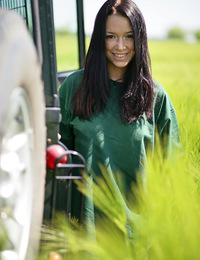 Gwen A: Artemis by Jan Kruml - Gwen playfully strips her green shirt matching the green grassy field and poses naughtily all over the jeep, flaunting