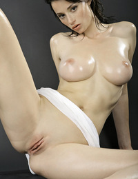 Lean model with good size breasts oils up her white shirt and plays with them. - Nastya I - Olikian