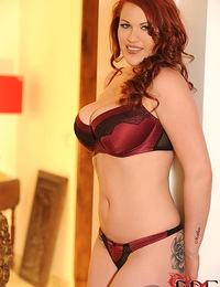 Tattooed Busty redhead babe Paige sensually stripping for us