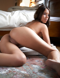 Tan skin and big breasts for this brunette as she smiles and plays on the bed. - Avia A - Fascination