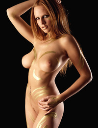 Body art does not look bad when you put it on the right body who has large breasts and big lips. - Monika A - Dorata